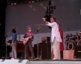 Money For Nothing (Live at Live Aid, Wembley Stadium, 13th July 1985) Dire Straits & Sting Rock Music Video 1985 New Songs Albums Artists Singles Videos Musicians Remixes Image